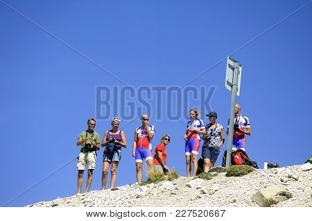 Mont-ventoux, France - September 1, 2016: A Group Of Cyclists Happy To Enjoy Being Arrived At The Su