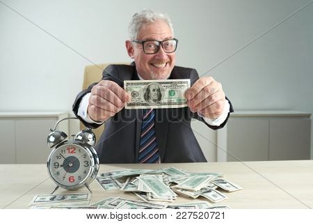 Happy Excited Rich Businessman Showing Hundred Dollar Bill