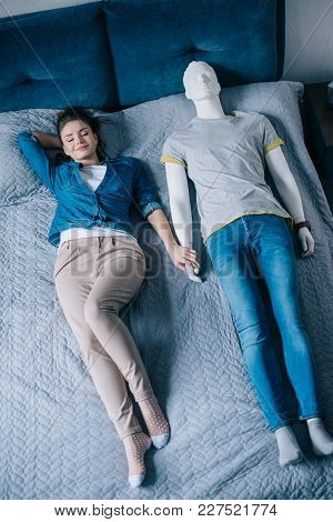 Young Woman Lying In Bed With Mannequin, Perfect Relationship Dream Concept