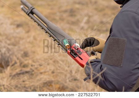 Close Up Picture Of Pump Action Shotgun Reloading