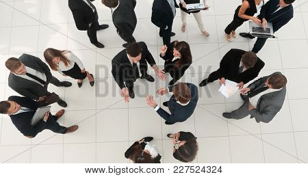 business concept.business partners talking in the lobby of the office