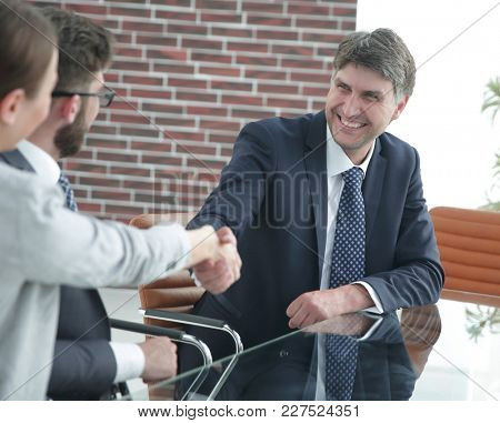 Handshake of business partners at a meeting