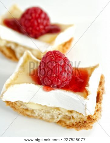 Closeup Of Toast With Brie And Raspberry.