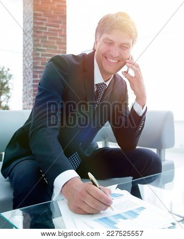 businessman with a smartphone in the workplace