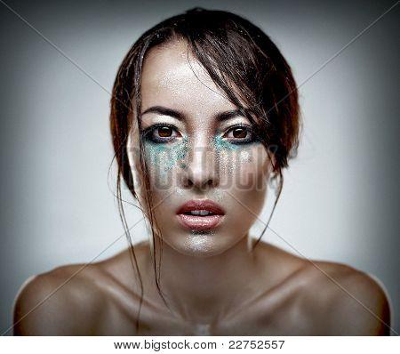 Beauty Head Shot Of A Woman With Heavu Makeup