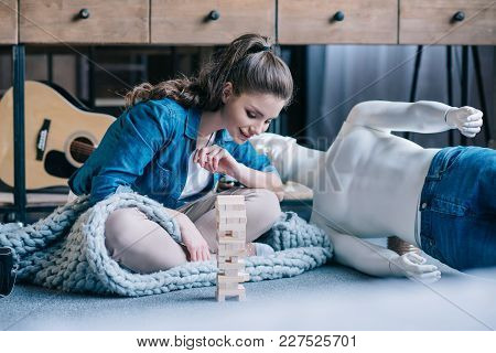 Woman Playing Blocks Wood Game With Layman Doll Near By At Home, Perfect Relationship Dream Concept