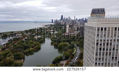 Aerial Elevated View Up Above North Pond In Park, Diversey Harbor, Lake Michigan With Chicago Downto