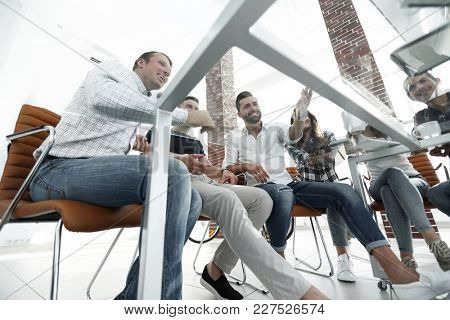 employees sitting behind a Desk
