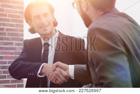 handshake reliable partners in the office.