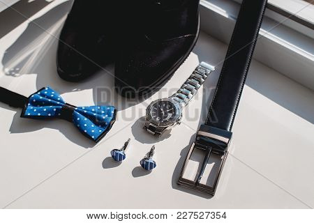 Black Leather Shoes And Belt, Watch, Blue Bow Tie And Cufflinks, On A White Window Sill. Accessory F