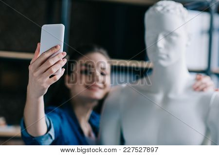 Selective Focus Of Smiling Woman Taking Selfie Together With Mannequin, Perfect Relationship Dream C