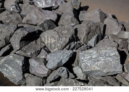 Close Up Of Manganese Ore Rocks Moving On A Conveyor Belt For Processing