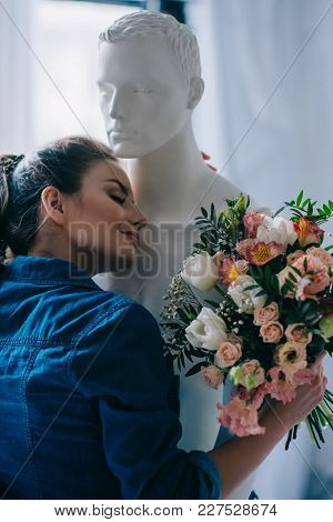Young Woman With Bouquet Of Flowers Hugging Layman Doll, Perfect Relationship Dream Concept