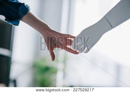 Cropped Shot Of Woman And Mannequin Holding Hands, Loneliness Concept