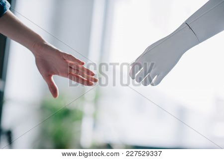 Partial View Of Female Hand And Mannequins Hand, Loneliness Concept