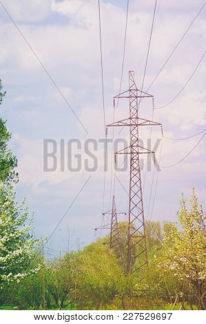 High-tension power line with clouds