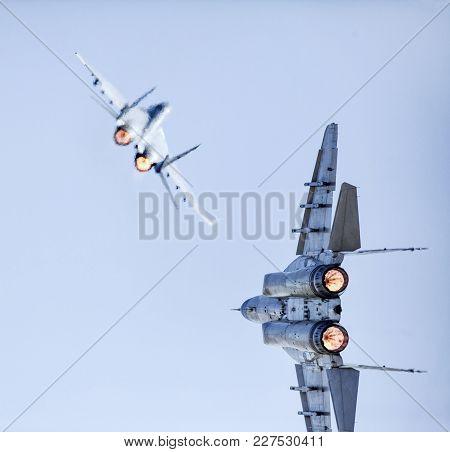 Two Fast Fighter Jets Flyby In A Battle Like Flight.