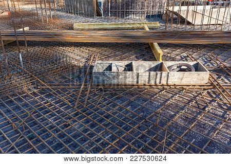 Construction workers fabricating steel reinforcement bar at the construction site.The reinforcement bar was ties together using tiny wire. poster