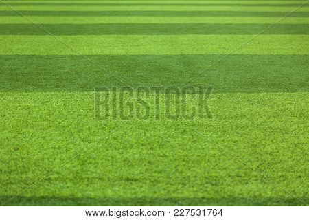Green Grass Background Turf Grass Surface Abstract. Artificial Turf Football Field
