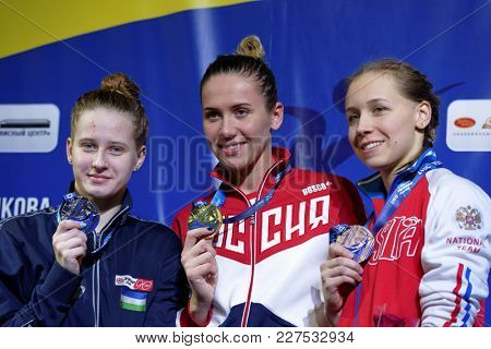 ST. PETERSBURG, RUSSIA - DECEMBER 22, 2017: Winners of XI Salnikov Cup in Women 50 m backstroke swimming Anastasia Fesikova (center), Polina Egorova (left) and Ksenia Vasilenok, all from Russia