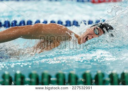 ST. PETERSBURG, RUSSIA - DECEMBER 22, 2017: Unidentified athlete in freestyle swimming competitions during Salnikov Cup. The Cup is recognized as a preliminary of 2018 World Swimming Championship