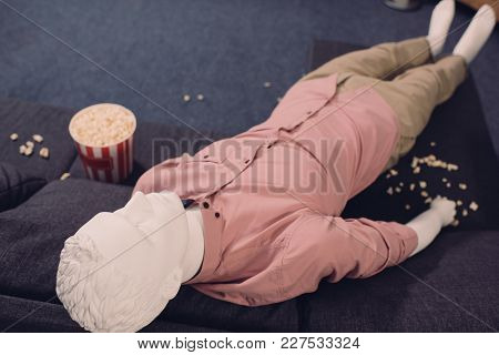 Close Up View Of Layman Doll In Casual Clothing And Popcorn