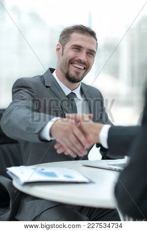 closeup .businessman holds out his hand for a handshake.