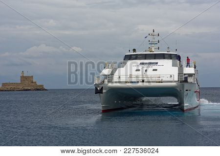 RHODES, GREECE - OCTOBER 7, 2017: Catamaran departs to Marmaris, Turkey. Travel from Rhodes to Marmaris takes one hour