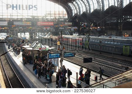 HAMBURG, GERMANY - DECEMBER 30, 2016: People on the platform of the central train station of Hamburg. Hamburg's main station is one of the most frequented passenger railway stations in Germany