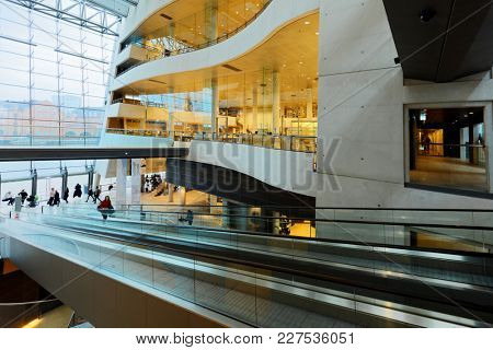 COPENHAGEN, DENMARK - DECEMBER 29, 2016: People in The Black Diamond building of Royal Danish Library. Designed by Danish architects Schmidt Hammer Lassen, the Black Diamond was completed in 1999