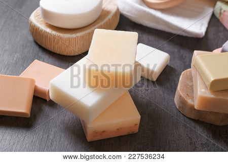 Different soap bars on table