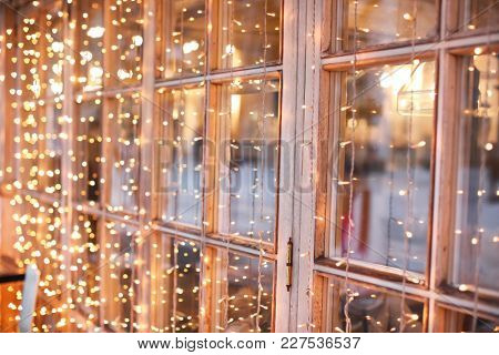 Beautiful Christmas lights on window, closeup