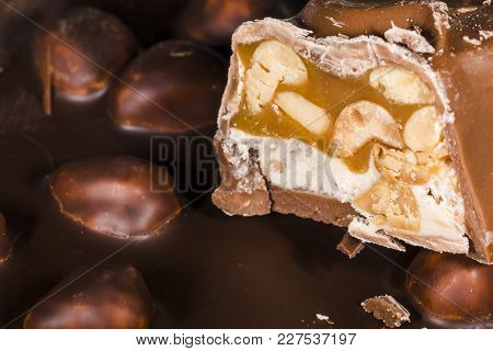 Cut Piece Of Chocolate With Nuts, Close-up , Background Image