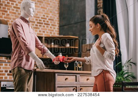 Woman Pretending To Except Gift From Mannikin, Loneliness And Perfect Man Dream Concept