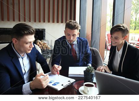 Business Team Analyzing Financial Document At Meeting