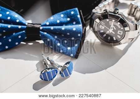 Black Leather Shoes, Watch, Blue Bow Tie And Cufflinks, On A White Window Sill. Accessory For Formal