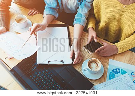 Close Up And Cut View Of Three Girls Sitting Together And Studying The Diagram Of Money Income. They