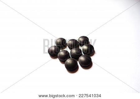 Bilberry Dietary Supplement Tablets On Neutral Background