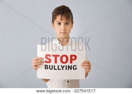Little boy holding sign with words