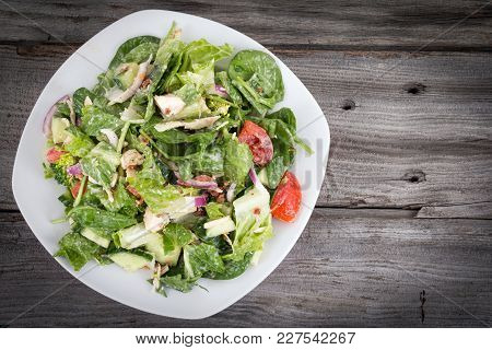 Chicken And Vegetables Delicious Salad With Ranch Dressing Over Wooden Background Table