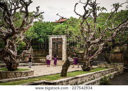 People Walk Near Uluwatu Temple