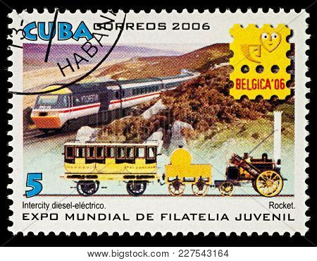 Moscow, Russia - Febuary 20, 2018: A Stamp Printed In Cuba, Shows Ancient Rocket Steam Locomotive An