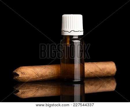 Liquid For Inhaling Pair Of Electronic Cigarettes, Next To Cigar, Isolated On Black Background