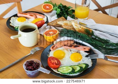 Homemade Breakfast With Fried Egg Toast Sausage Fruits Vegetable Beans Coffee And Orange Juice. Deli