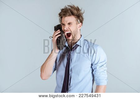 Overworking Businessman With Messy Hair Yelling In Shoe As Phone Isolated On Grey