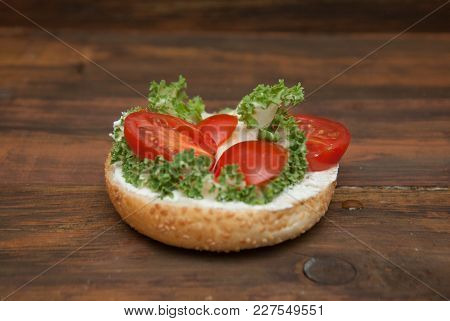 Step By Step Cooking Process Of Hamburger . Half Burger With Fresh Letuce Leaves And Tomatoe Slice,