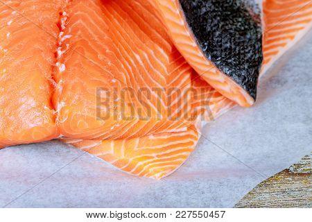 Fresh Salmon On The Wood Cutting Board. Delicious Salmon Steak With Fresh