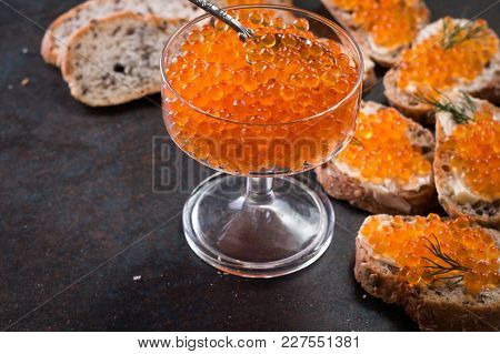Delicious Bright Red Fresh Snack Red Caviar On A Wooden Background. Silver Spoon With Caviar. Expens