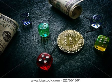 Bitcoin With Dice And Hundred Dollar Bills