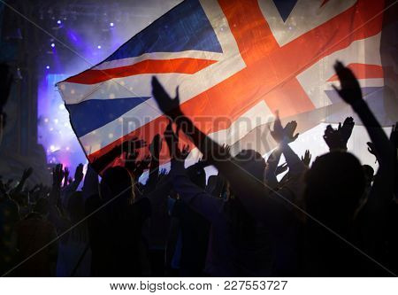 Crowd of people and Union Jack flag - People celebratin in UK